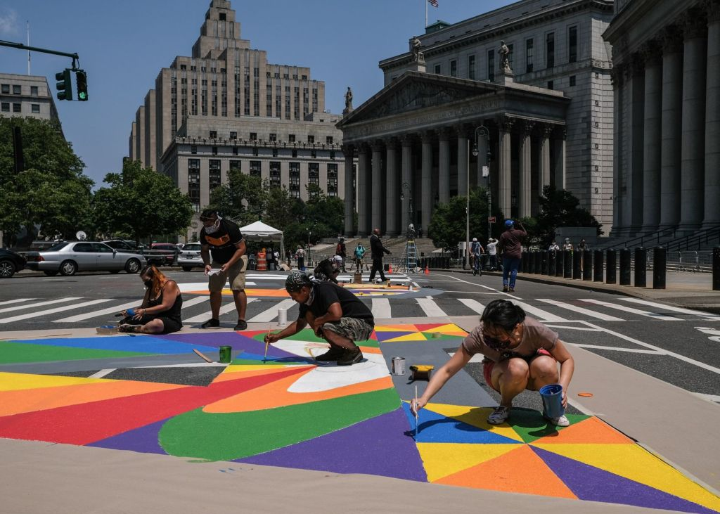 New Yorkers at work on a Black Lives Matter mural in Manhattan in July. Such scenes became increasingly common in U.S. cities since June.  Photographer: Byron Smith/Getty Images North America